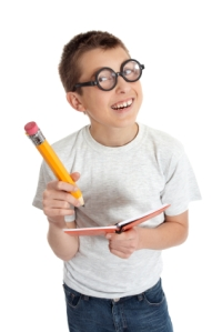 Geeky student child wearing glasses